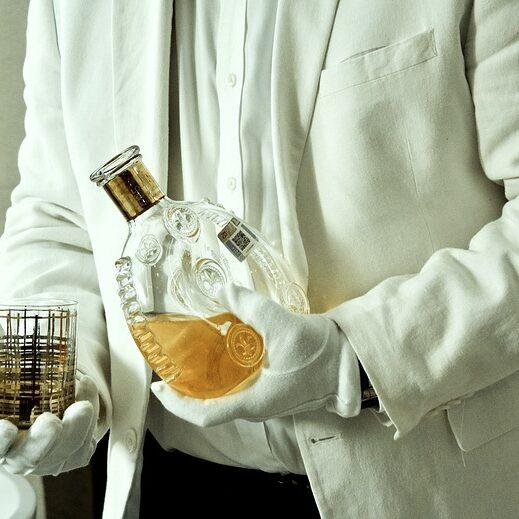 butler serving whisky